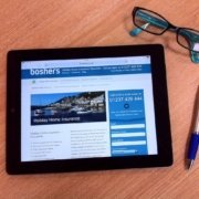 Boshers specialist holiday home insurance webite on ipad